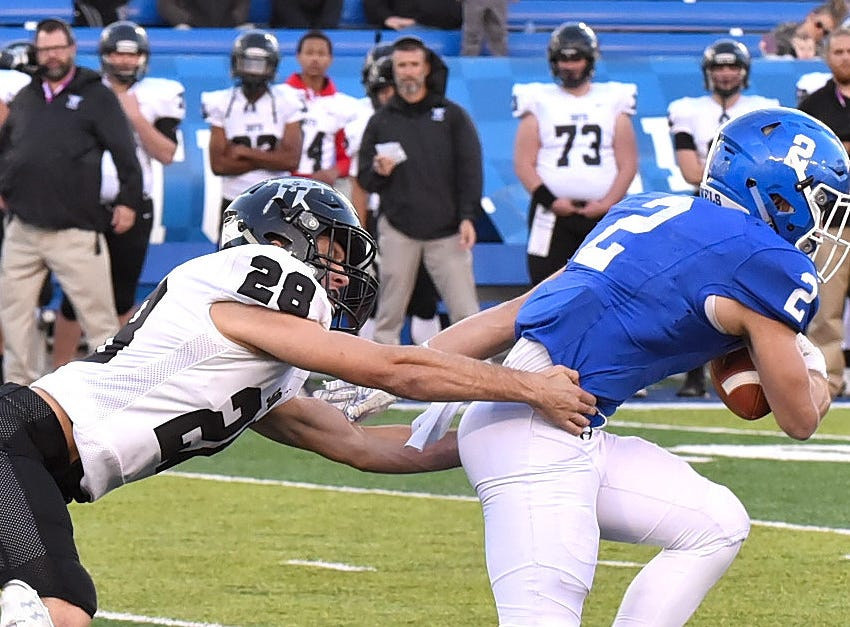 Casey McGuinness (2) of Covington Catholic breaks out of the grasp of South Warren's Rowdy Shea (28) on his way to the endzone to cut the deficit to 6 in the 2018 KHSAA 5A State Football Championship, December 2, 2018.