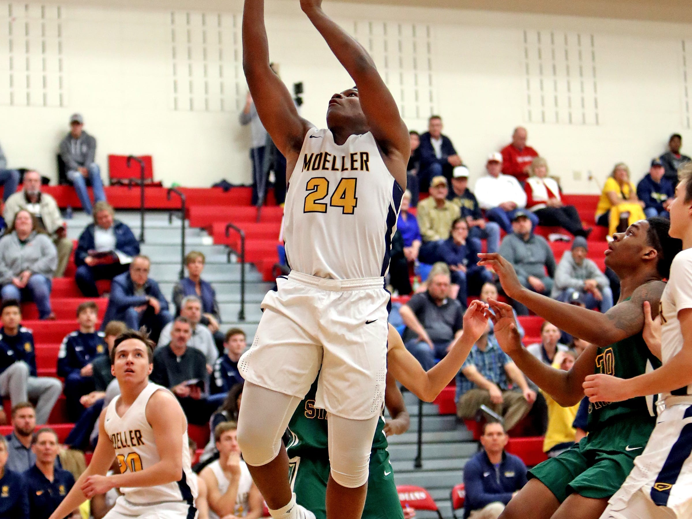 Moeller forward Alex Williams scores from the paint at the Ohio Valley Hoops Classic at Hillsboro High School. Moeller defeated Bryan Station 85-42.
