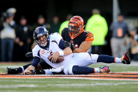 Cincinnati Bengals defensive end Jordan Willis (75) sacks Denver Broncos quarterback Case Keenum (4) in the fourth quarter of a Week 13 NFL football game, Sunday, Dec. 2, 2018, at Paul Brown Stadium in Cincinnati. The Denver Broncos won and the Cincinnati Bengals fell to 5-7 on the season with the loss.