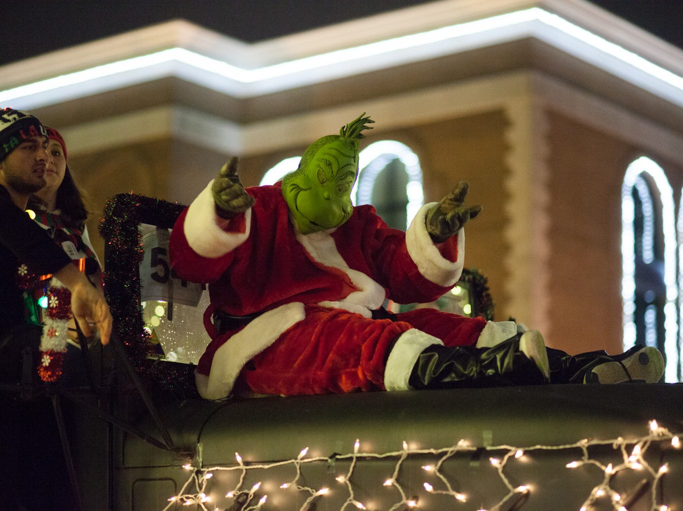 The Grinch passes Clarksville's City Hall as the Parade moves through Downtown on Saturday, Dec. 1, 2018, in Clarksville, Tenn.