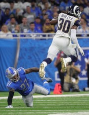 Glover Quin misses a tackle on Rams running back Todd Gurley during the first half Sunday.