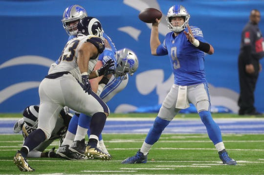 Detroit Lions quarterback Matthew Stafford is rushed by  Los Angeles Rams defensive tackle Ndamukong Suh during second half action Sunday, December 2, 2018 at Ford Field in Detroit, Mich.