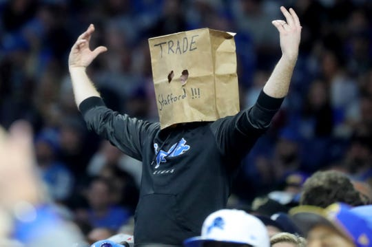 A Detroit Lions fan wears a bag over his head after a Stafford fumble during during the second half on Sunday, December 2, 2018 at Ford Field in Detroit.