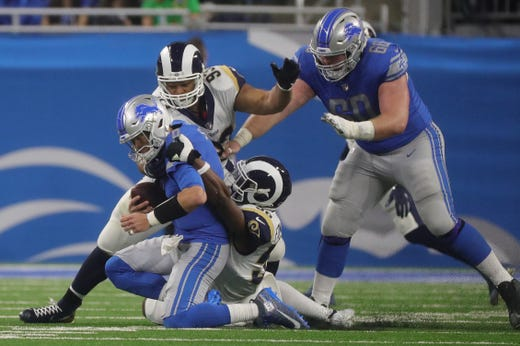 19fdfff75e9 Detroit Lions quarterback Matthew Stafford is sacked by Los Angeles Rams  Ndamukong Suh and Dante Fowler