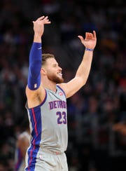 Blake Griffin celebrates after a basket against the Warriors during the fourth quarter.