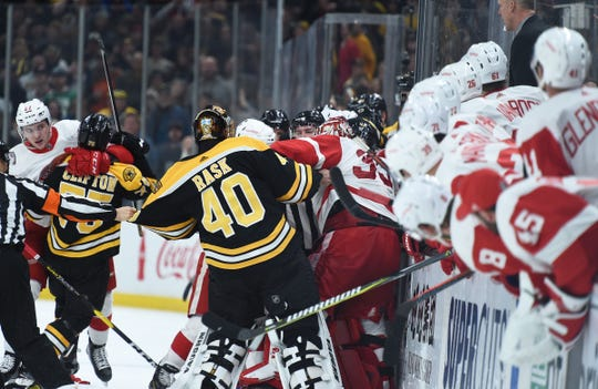 Boston Bruins goaltender Tuukka Rask fights with Detroit Red Wings goaltender Jimmy Howard during a scrum in the second period at TD Garden, Saturday, Dec. 1, 2018.