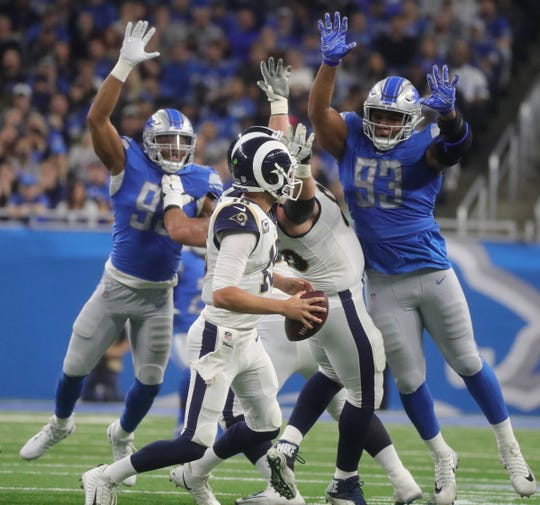 Detroit Lions defenders rush Los Angeles Rams quarterback Jared Goff during the second half on Sunday, December 2, 2018 at Ford Field in Detroit.
