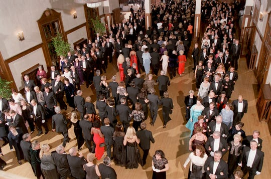 The Grand March during the Officers' Ball in January at the Detroit Yacht Club. Guests march to big band music and everyone can participate.