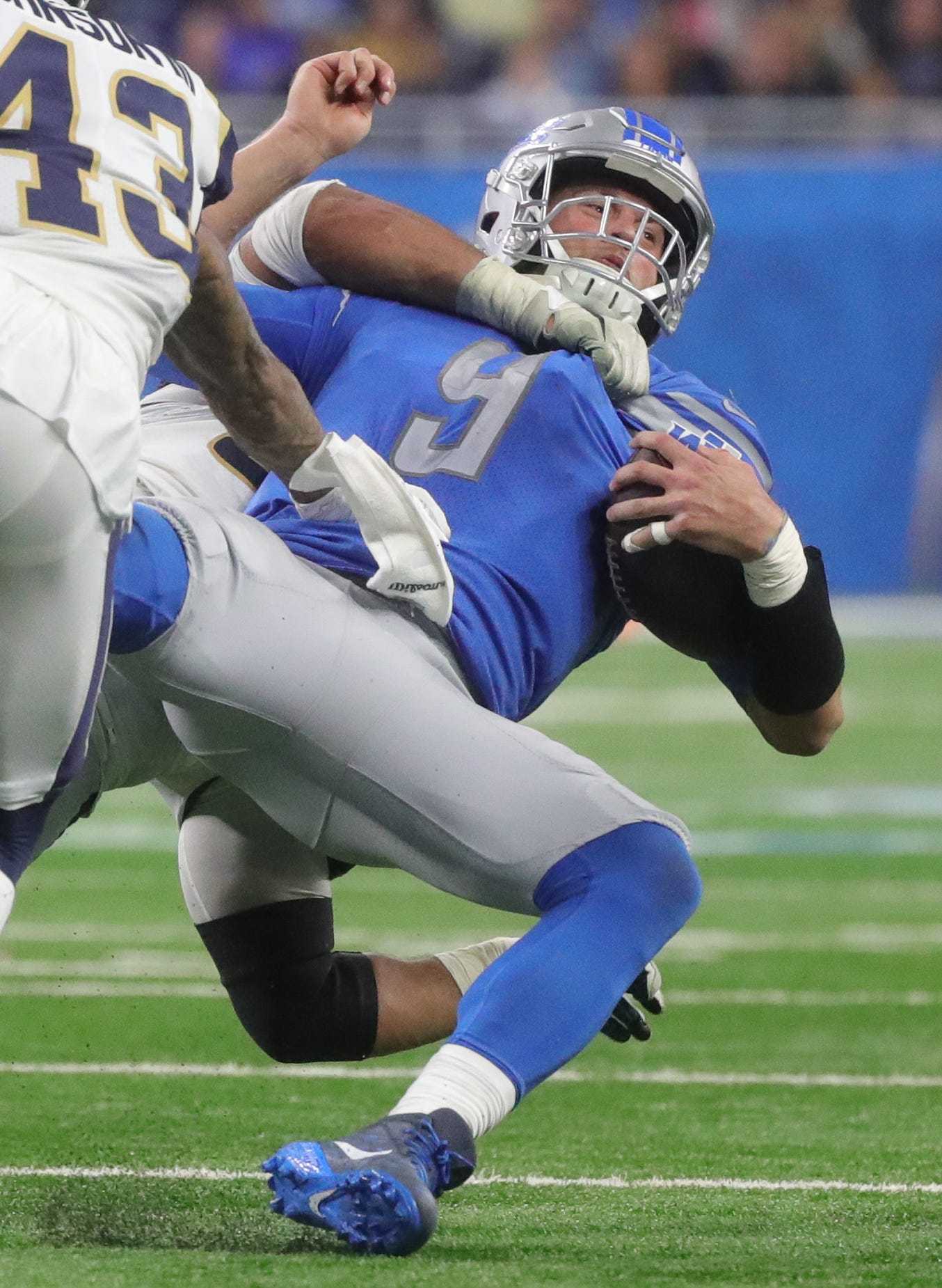 Detroit Lions quarterback Matthew Stafford is slammed to the ground by Los Angeles Rams defensive tackle Aaron Donald in the second half Sunday, Dec. 2, 2018 at Ford Field in Detroit.