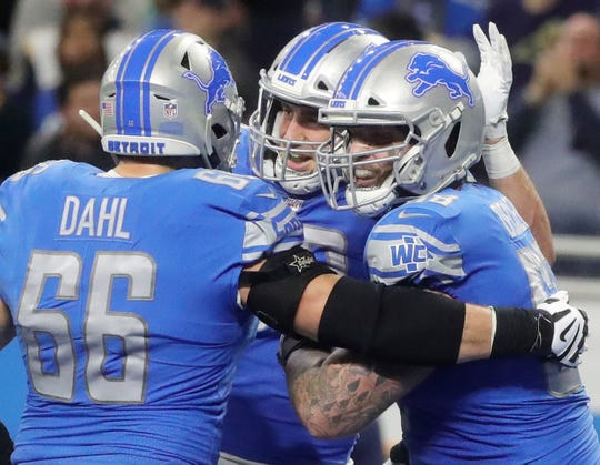 Detroit Lions left tackle Taylor Decker, right, celebrates his touchdown with lineman Joe Dahl against the Los Angeles Rams during the second half Sunday, Dec. 2, 2018 at Ford Field in Detroit.