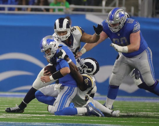 Lions quarterback Matthew Stafford is sacked by Rams Ndamukong Suh (93) and Dante Fowler Jr. (56) during the first half on Sunday, Dec. 2, 2018, at Ford Field.