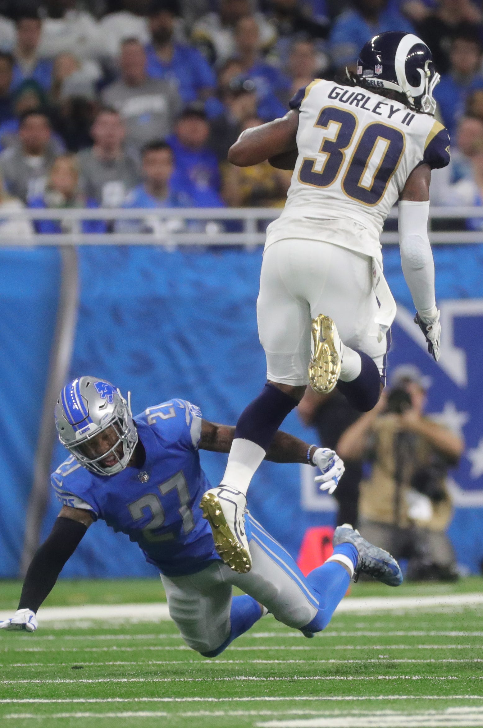Lions safety Glover Quin misses the tackle on Rams running back Todd Gurley II during the first half on Sunday, Dec. 2, 2018, at Ford Field.