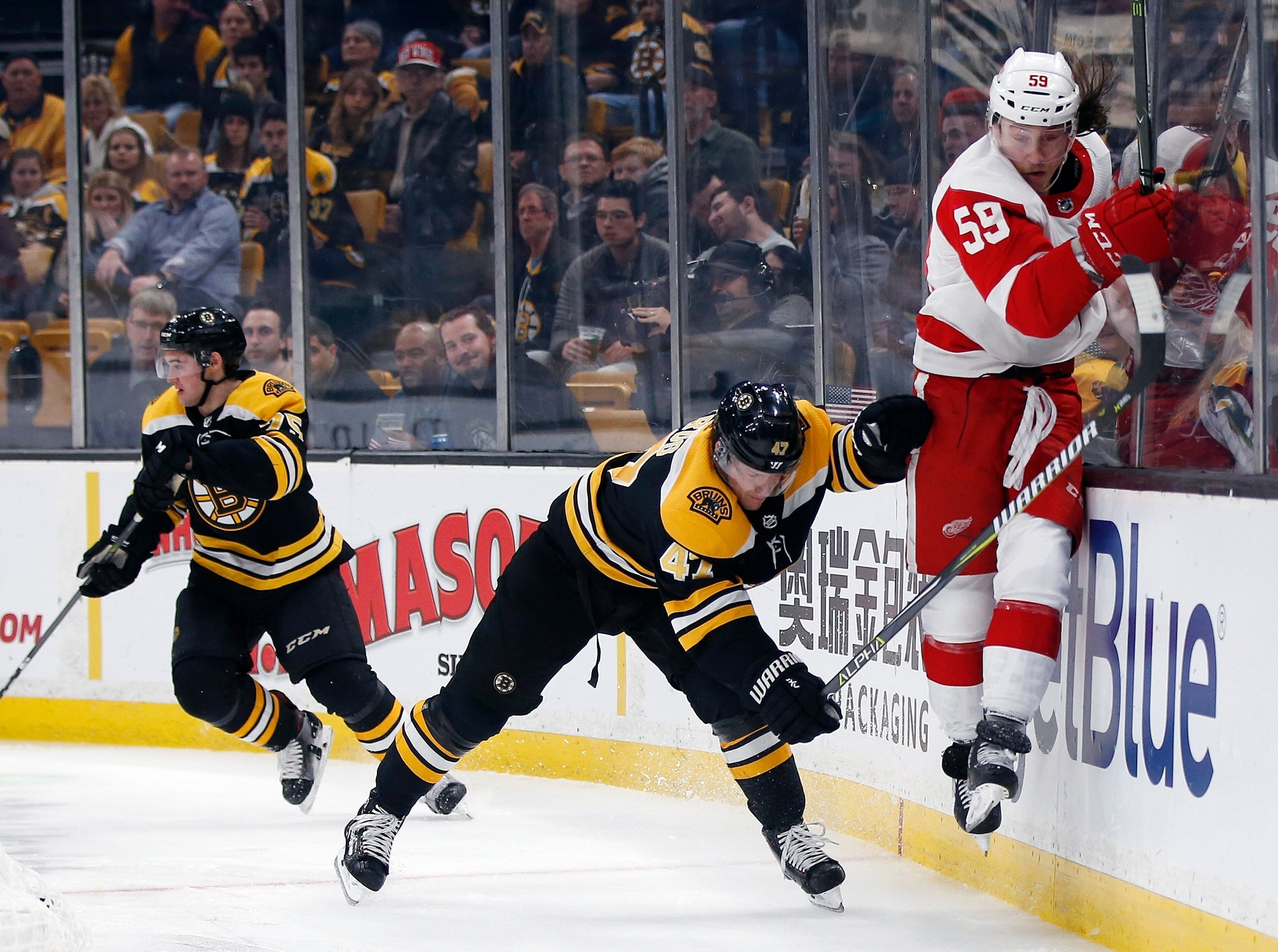 Boston Bruins' Torey Krug (47) checks Detroit Red Wings' Tyler Bertuzzi (59) during the third period.