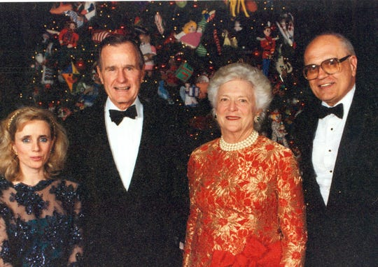John and Debbie Dingell pose with George H. W. Bush and Barbara Bush.
