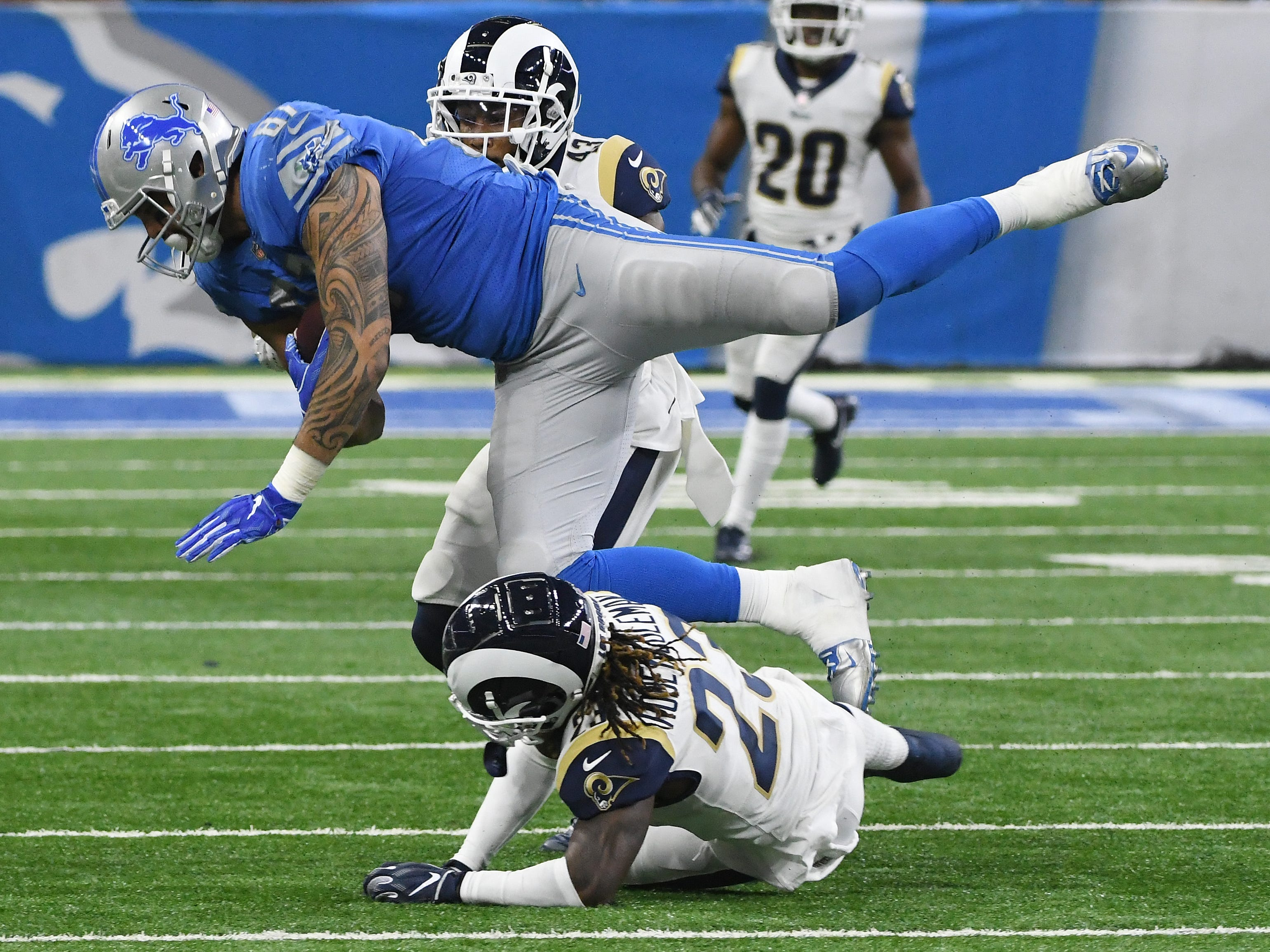 Lions' Levione Toilolo pulls in a reception over Rams' Nickell Robey-Coleman late in the fourth quarter.