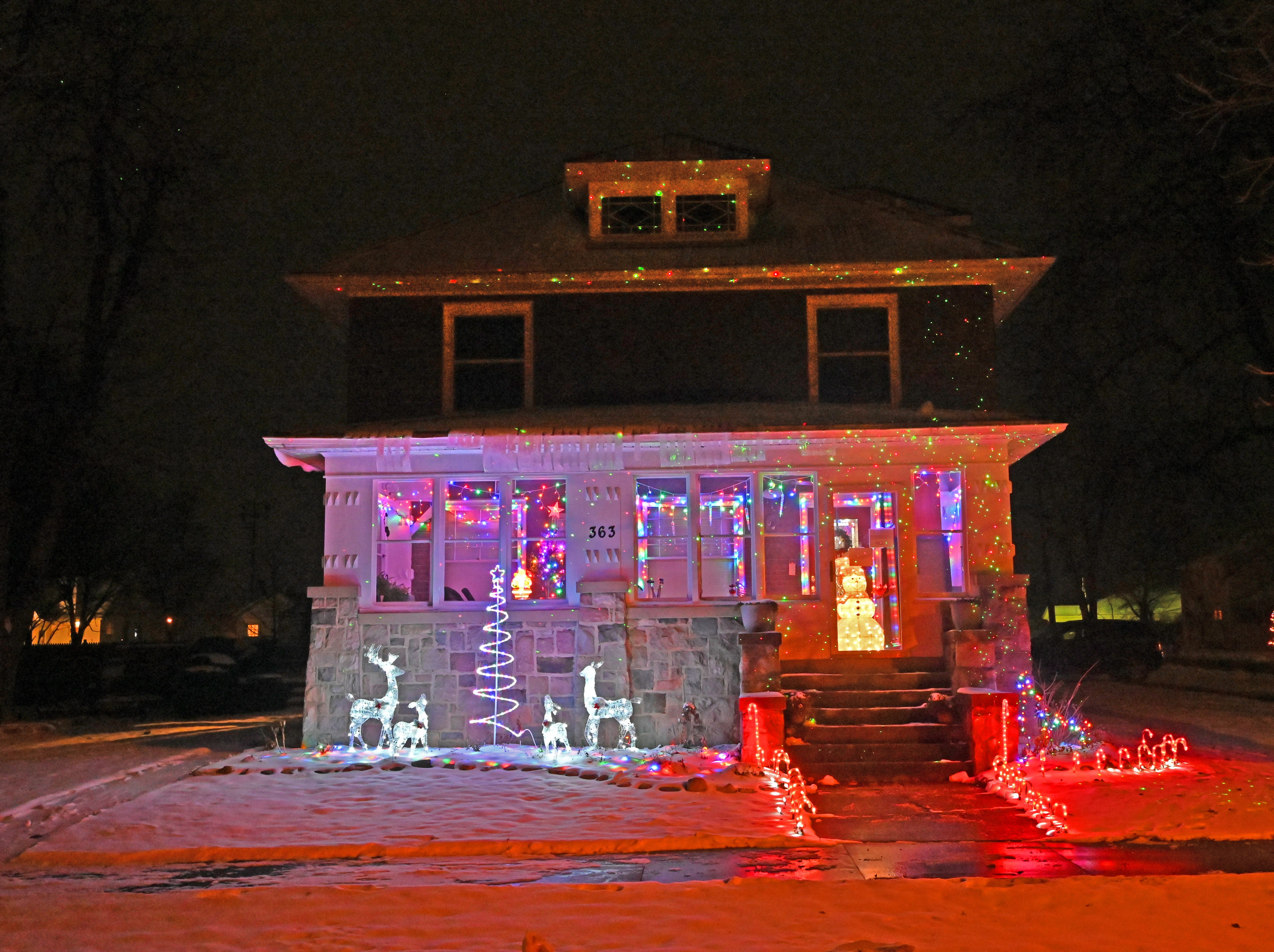 Traditional Christmas lights — including candy canes, reindeer and snowmen — decorate this home on Main Street in Fowler, Michigan.