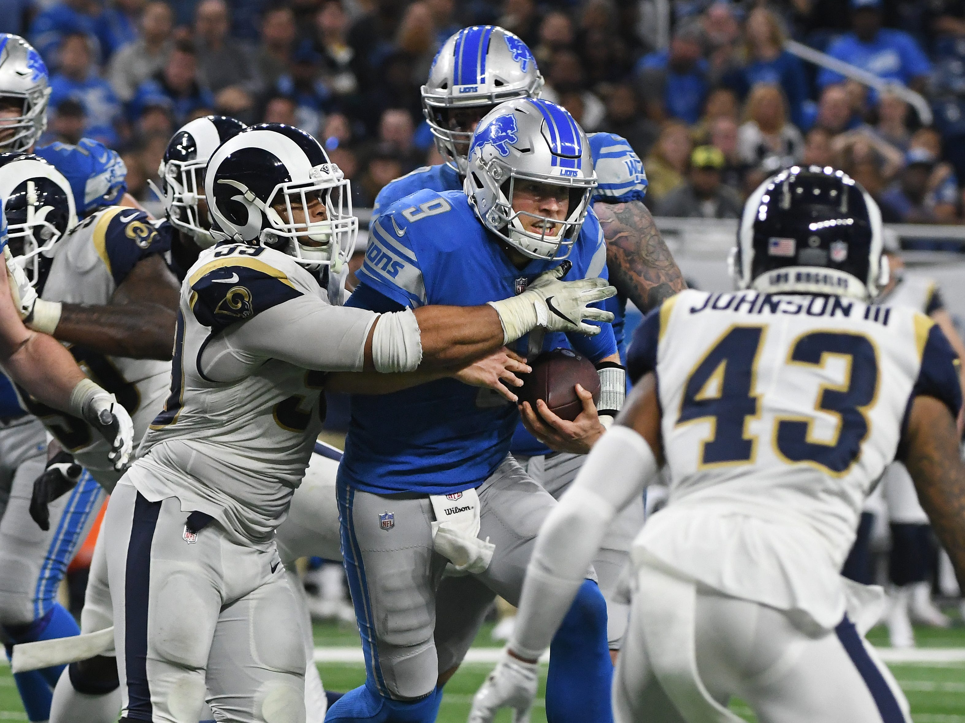 Lions' Matthew Stafford is pressured out of the pocket by Ethan Westbrooks and the Rams and is sacked, but off-setting penalties, forces both teams to replay the down in the fourth quarter.