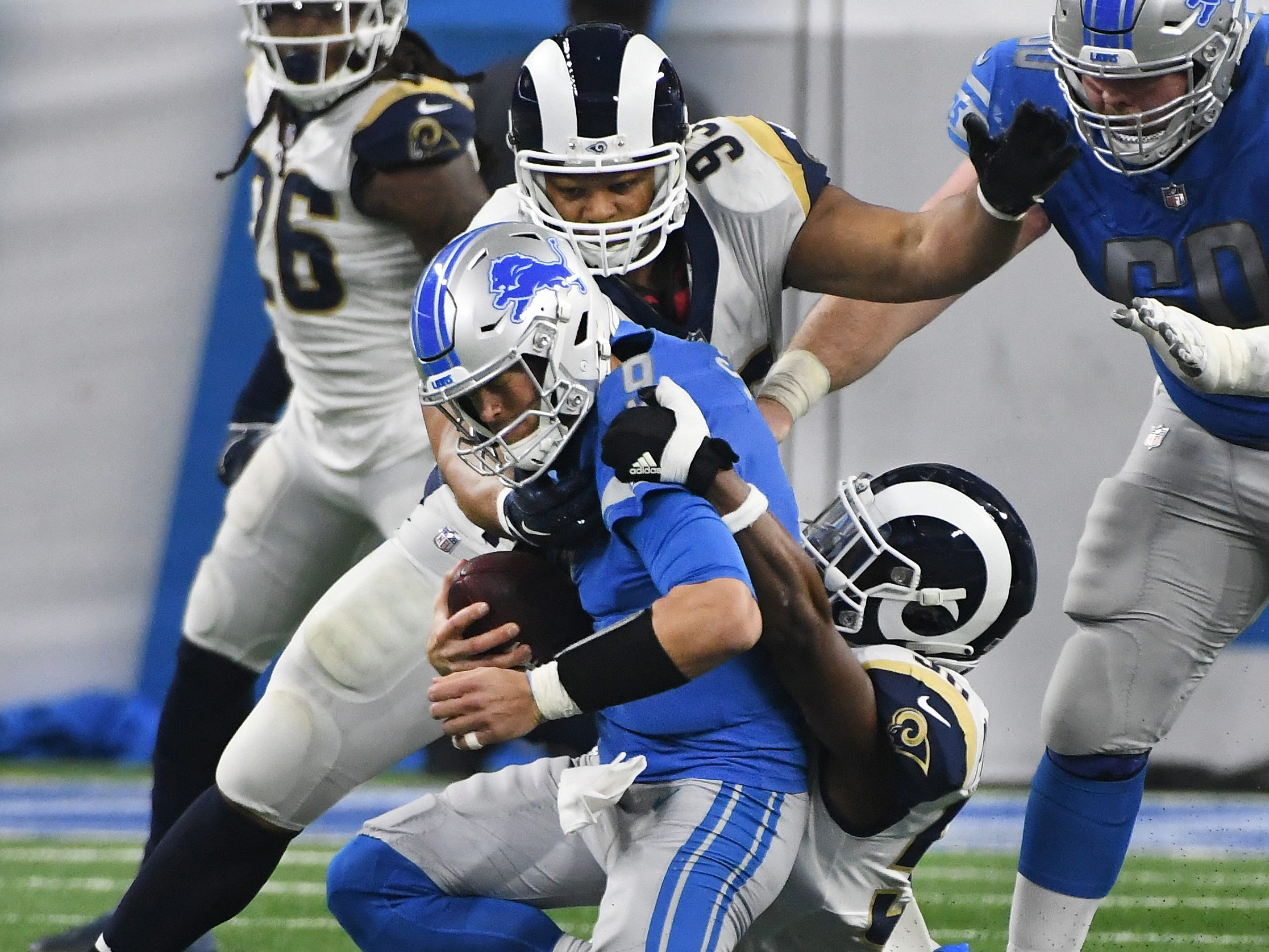 Lions quarterback Matthew Stafford is sacked by Ram's Cory Littleton, with former Lions, Rams defensive tackle Ndamukong Suh finishing it up in the first quarter of the 30-16 loss to Los Angeles at Ford Field in Detroit, Michigan on December 2, 2018.