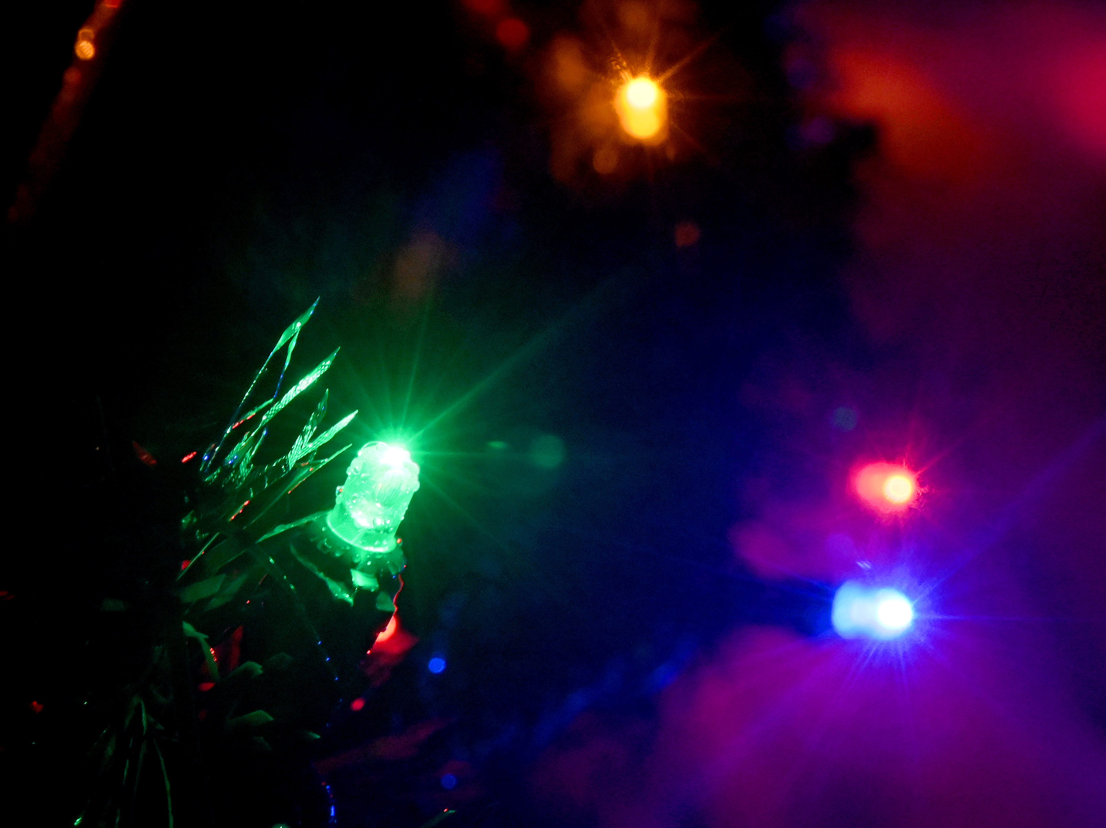 Christmas lights and evergreen ropes glisten through freezing rain in rural Clinton County.