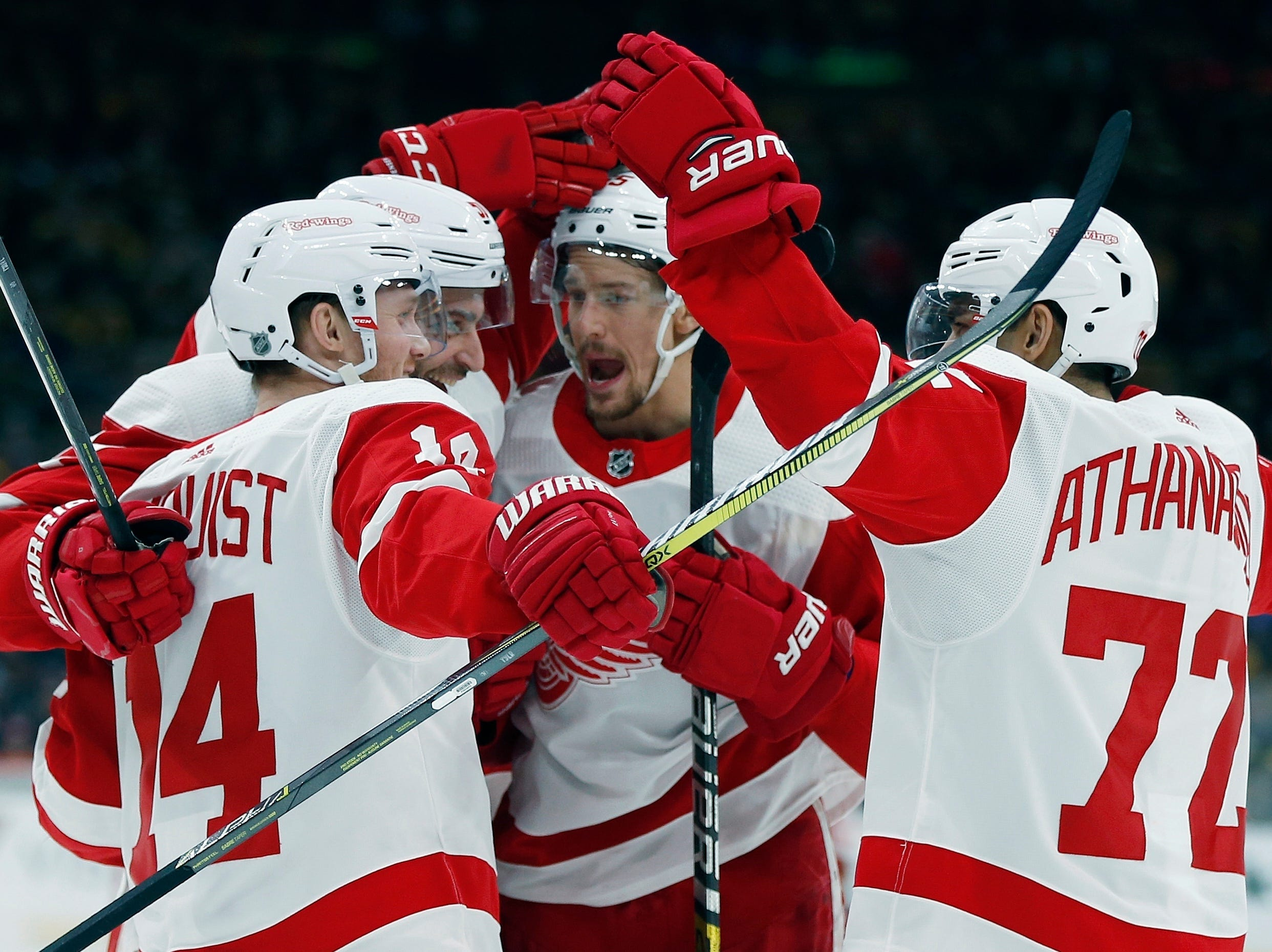 Detroit Red Wings' Frans Nielsen, second from left, celebrates his go-ahead goal with teammates, from left, Gustav Nyquist (14), Danny DeKeyser and Andreas Athanasiou (72) during the third period.