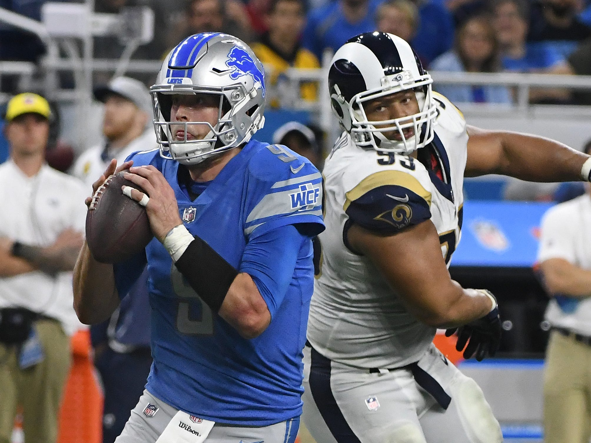 Lions quarterback Matthew Stafford scrambles out of the pocket, with pressure from Rams' Ndamukong Suh, but throws an incompletion in the end zone late in the fourth quarter.