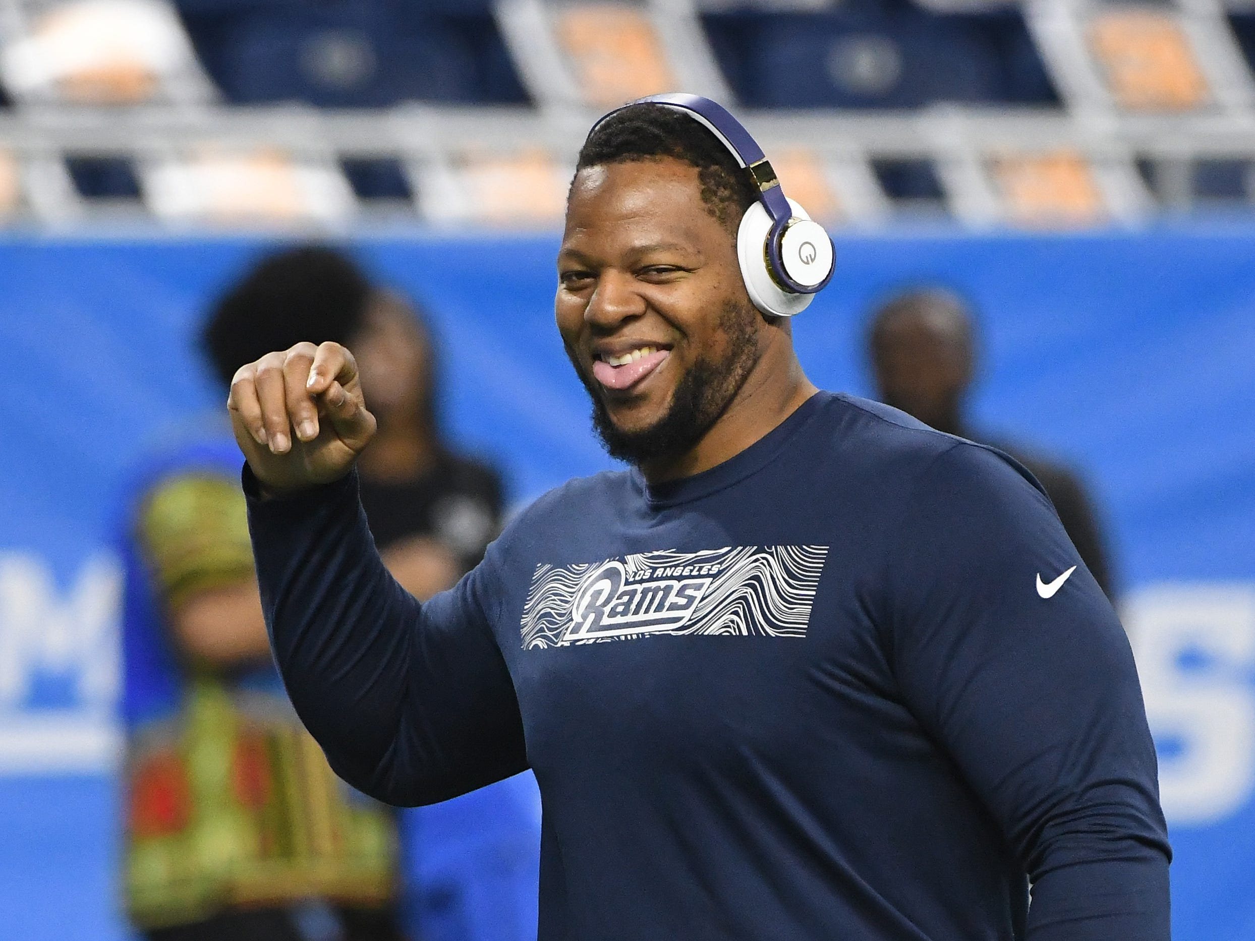 Former Detroit Lions, Los Angeles defensive tackle Ndamukong Suh leaves the field after warmups before Detroit takes on the Rams at Ford Field in Detroit, Michigan on December 2, 2018.