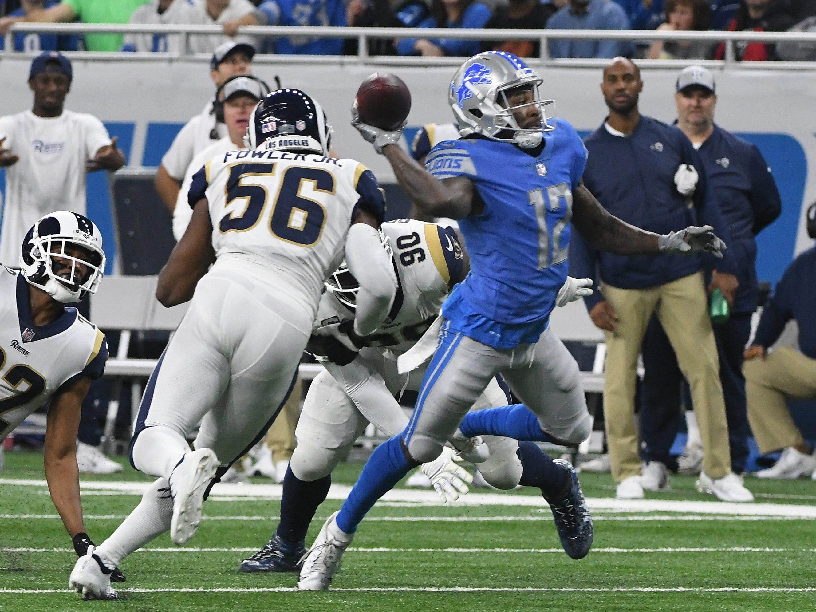 On a trick play, Lions wide receiver Bruce Ellington throws into the end zone after catching a lateral from quarterback Matthew Stafford but is incomplete in the third quarter.
