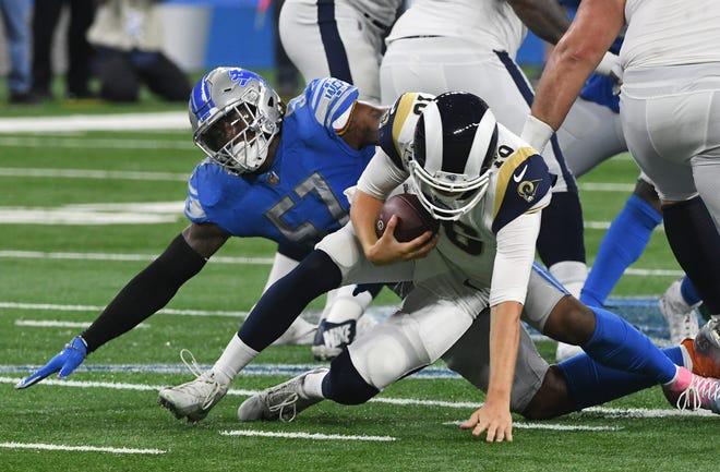 Lions' Eli Harold sacks Rams' Jared Goff in the fourth quarter.