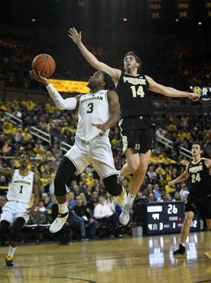Purdue guard Ryan Cline defends a drive by Michigan guard Zavier Simpson in the first half of a game last week.