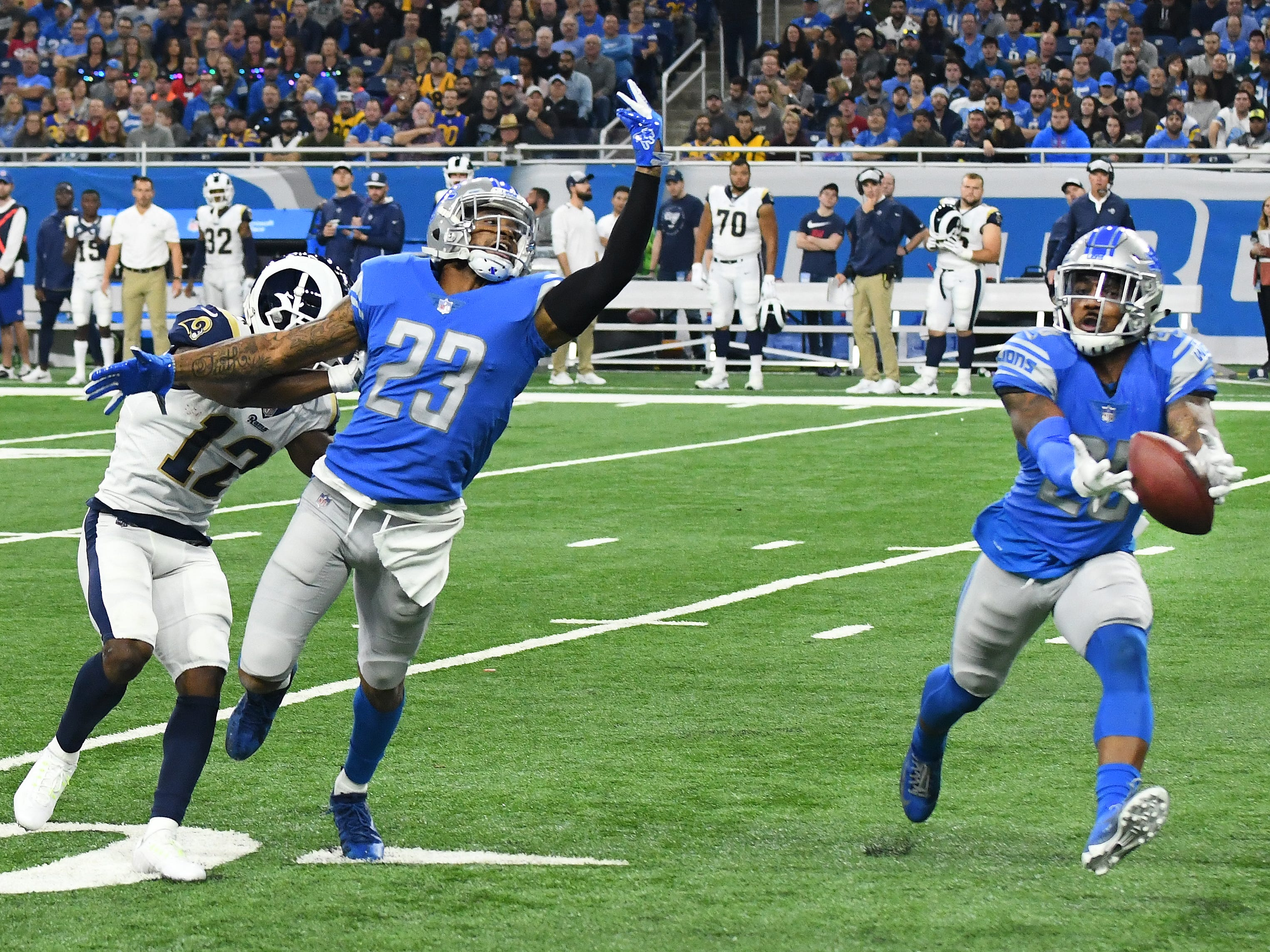 A pass intended for Ram's Brandin Cooks goes over his head as well as over the hand of Lions Darius Slay but waiting is Lions' Quandre Diggs who makes the interception in the second quarter.