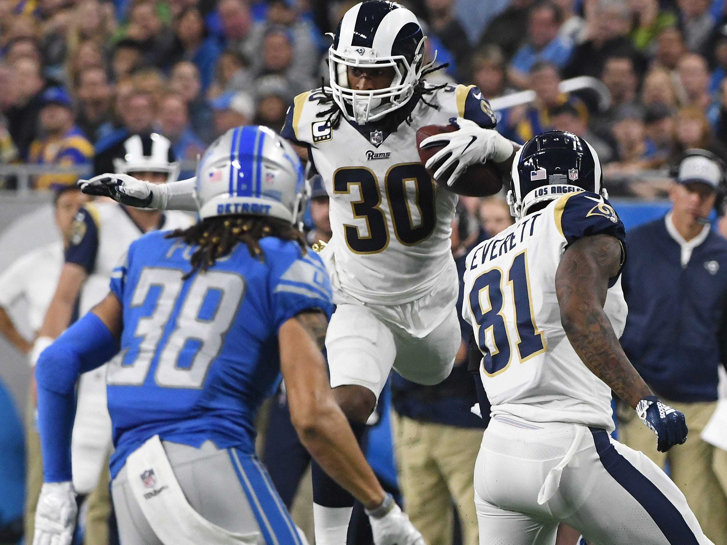 Rams running back Todd Gurley II works the ball up field in the second quarter, but a Rams penalty calls the play back.