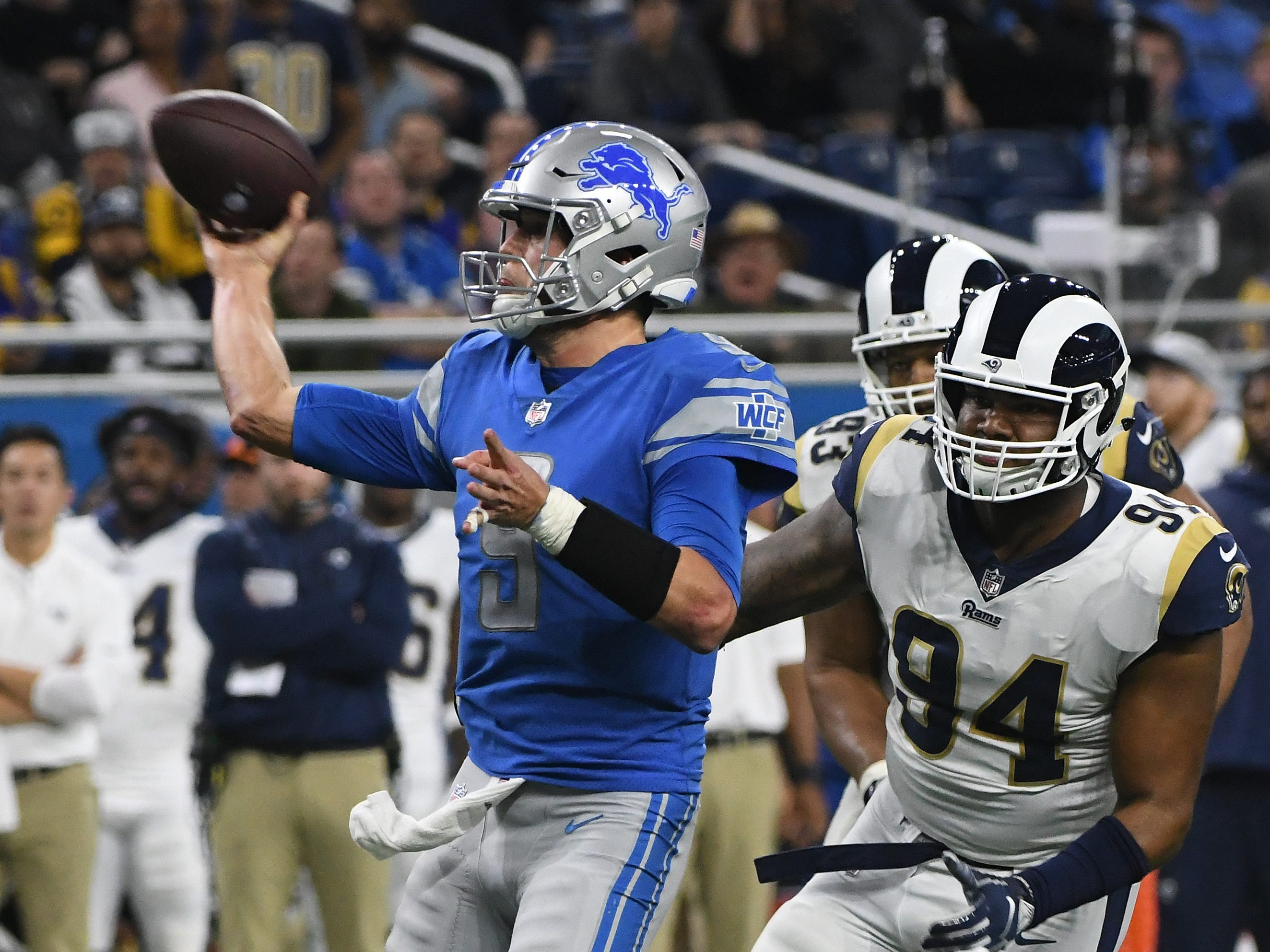 Lions quarterback Matthew Stafford scrambles out of the pocket but throws an incompletion in the end zone late in the fourth quarter.