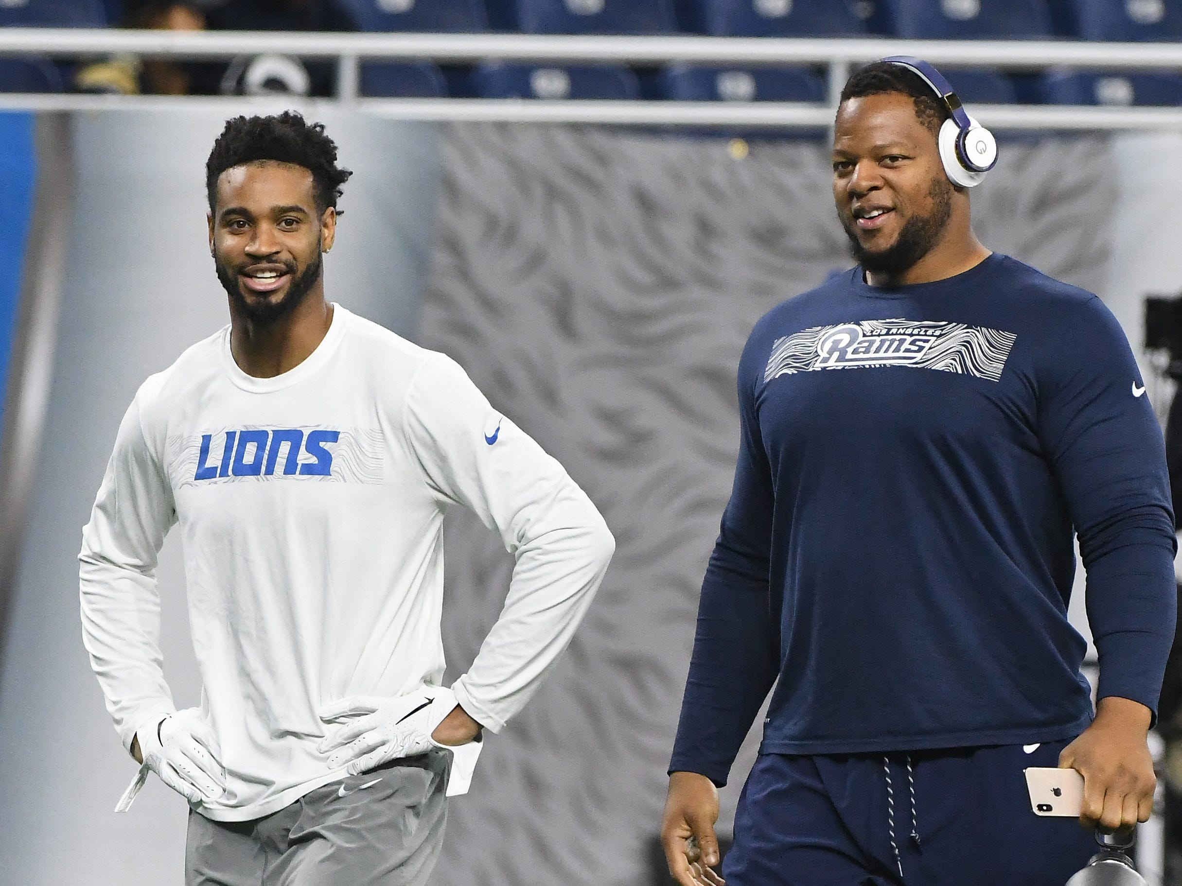 Lions' cornerback Darius Slay and former Detroit Lions, Los Angeles defensive tackle Ndamukong Suh chat as they leave the field before Detroit takes on the Rams at Ford Field in Detroit, Michigan on December 2, 2018.