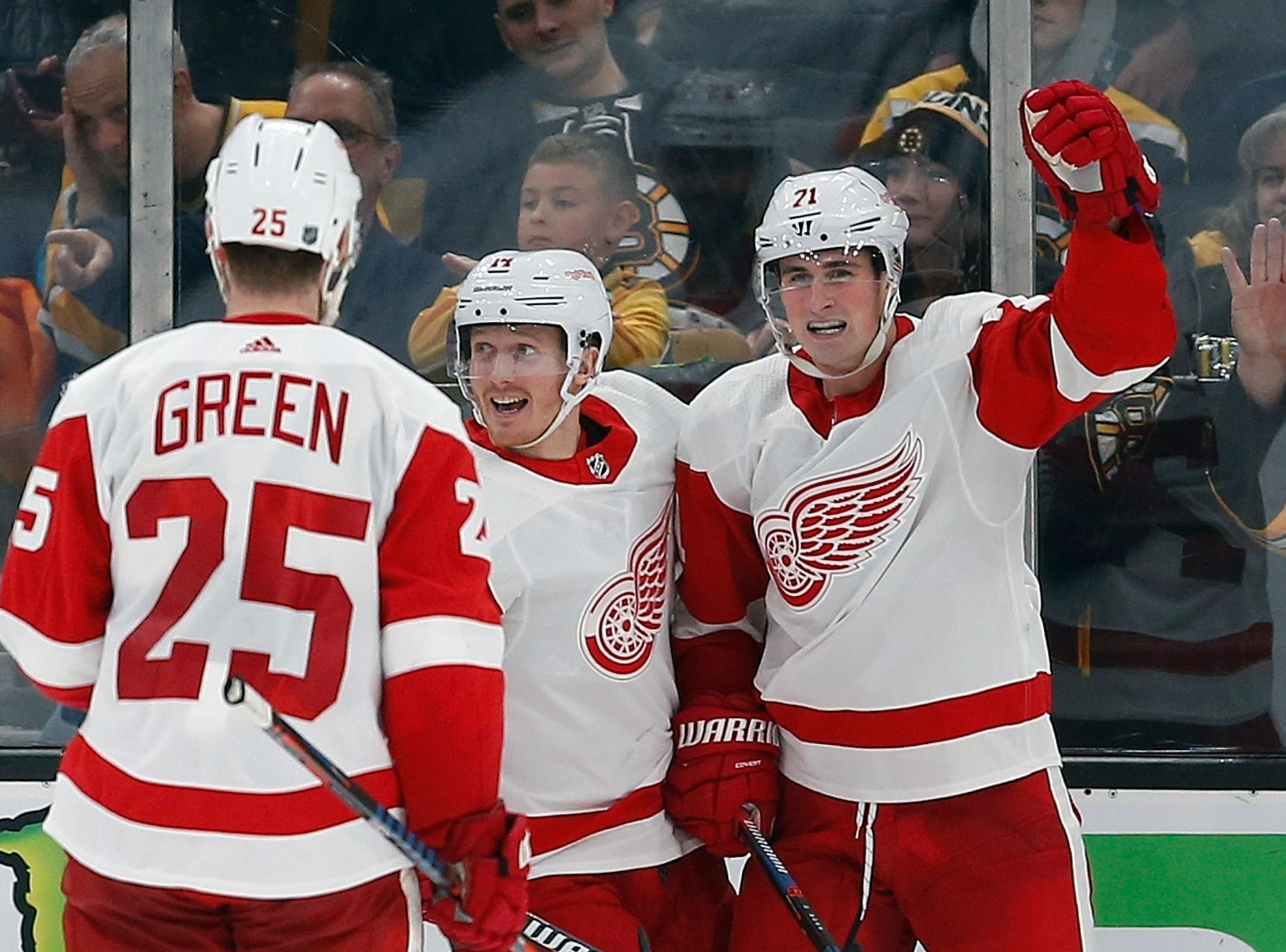 Detroit Red Wings' Dylan Larkin (71) celebrates his goal with teammates Gustav Nyquist (14) and Mike Green (25) during the second period.