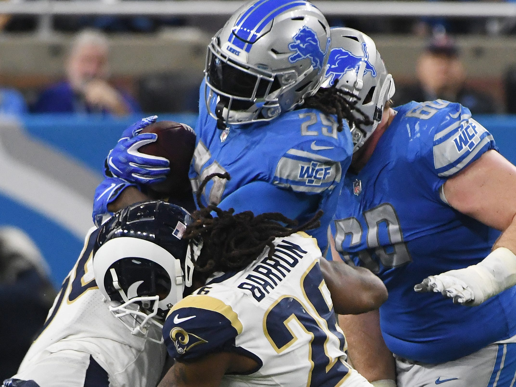 Lions running back LeGarrette Blount is stopped by the Rams defense in the third quarter.