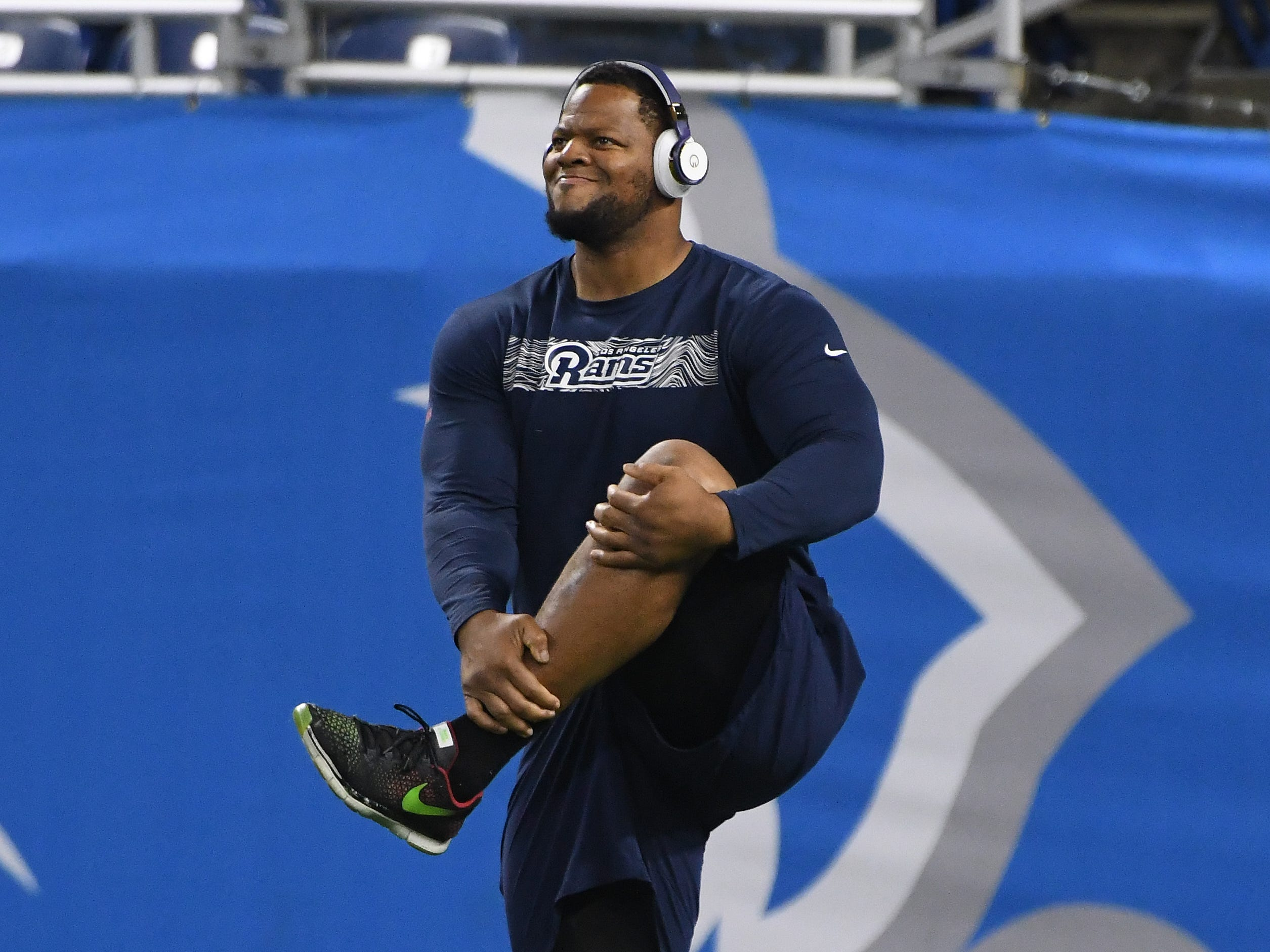 Former Detroit Lions, now Los Angeles Rams defensive tackle Ndamukong Suh warms up on the field before the game at Ford Field.