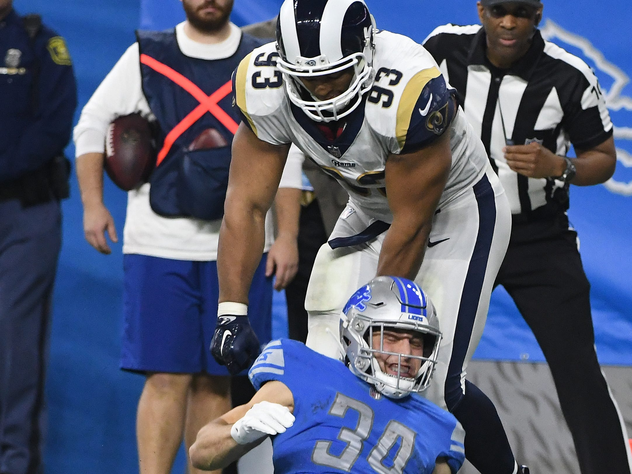 Rams' Ndamukong Suh gets a horse-collar penalty bringing down Lions running back Zach Zenner in the third quarter.