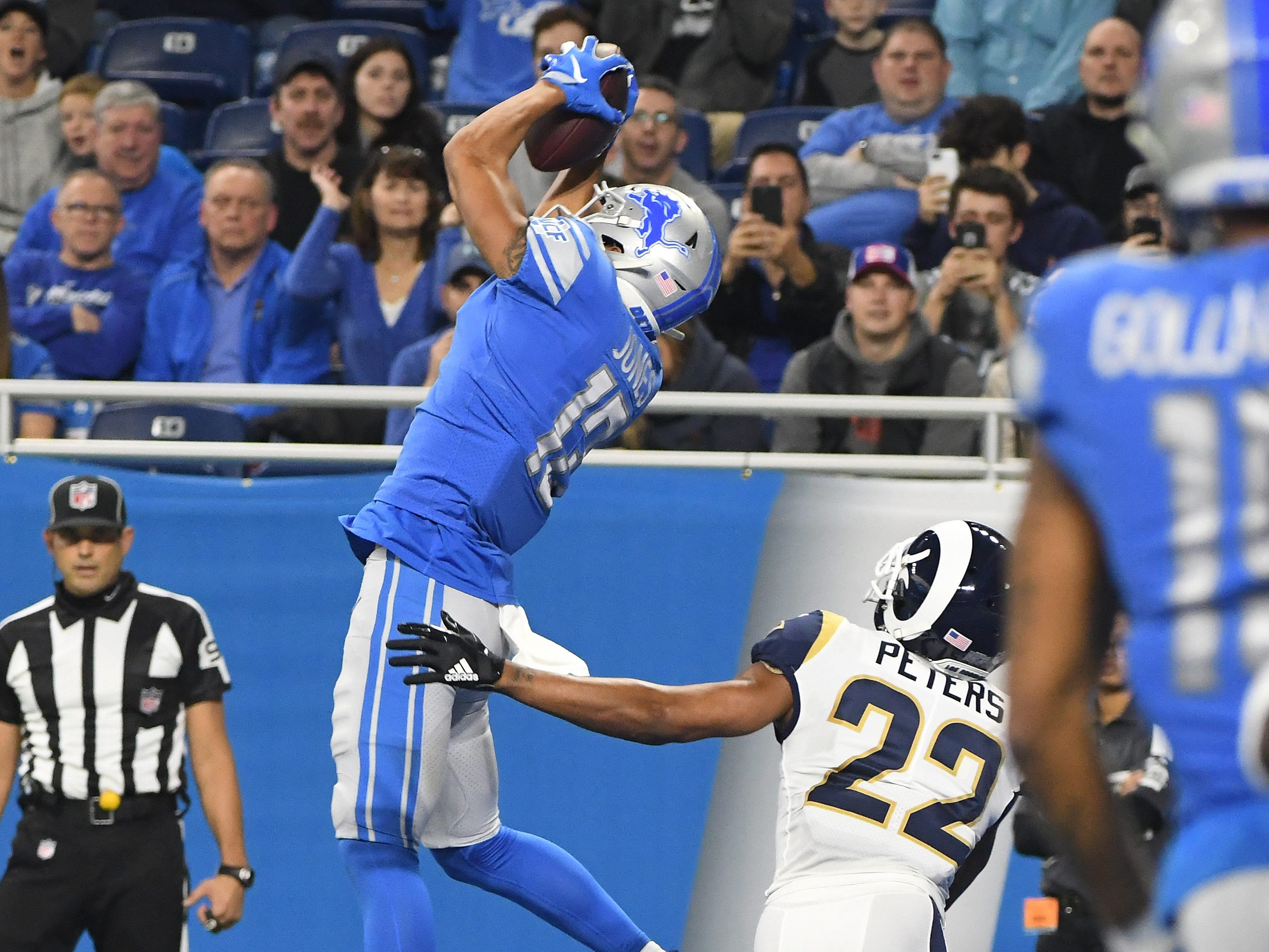 Lions' T.J. Jones pulls in a reception in front of Rams' Marcus Peters but is is waved off on an offensive interference call on Jones in the third quarter.