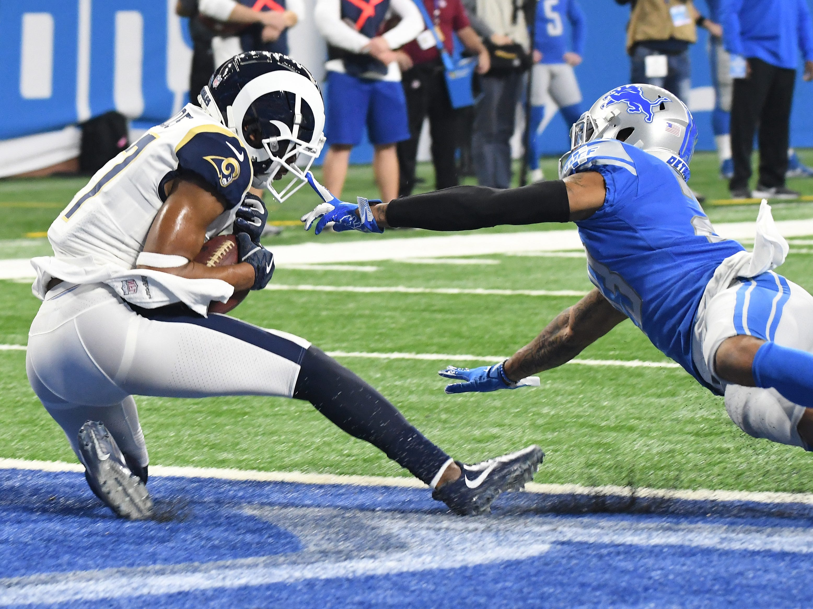 Rams' Robert Woods pulls in a touchdown reception under Lions' Darius Slay in the second quarter.