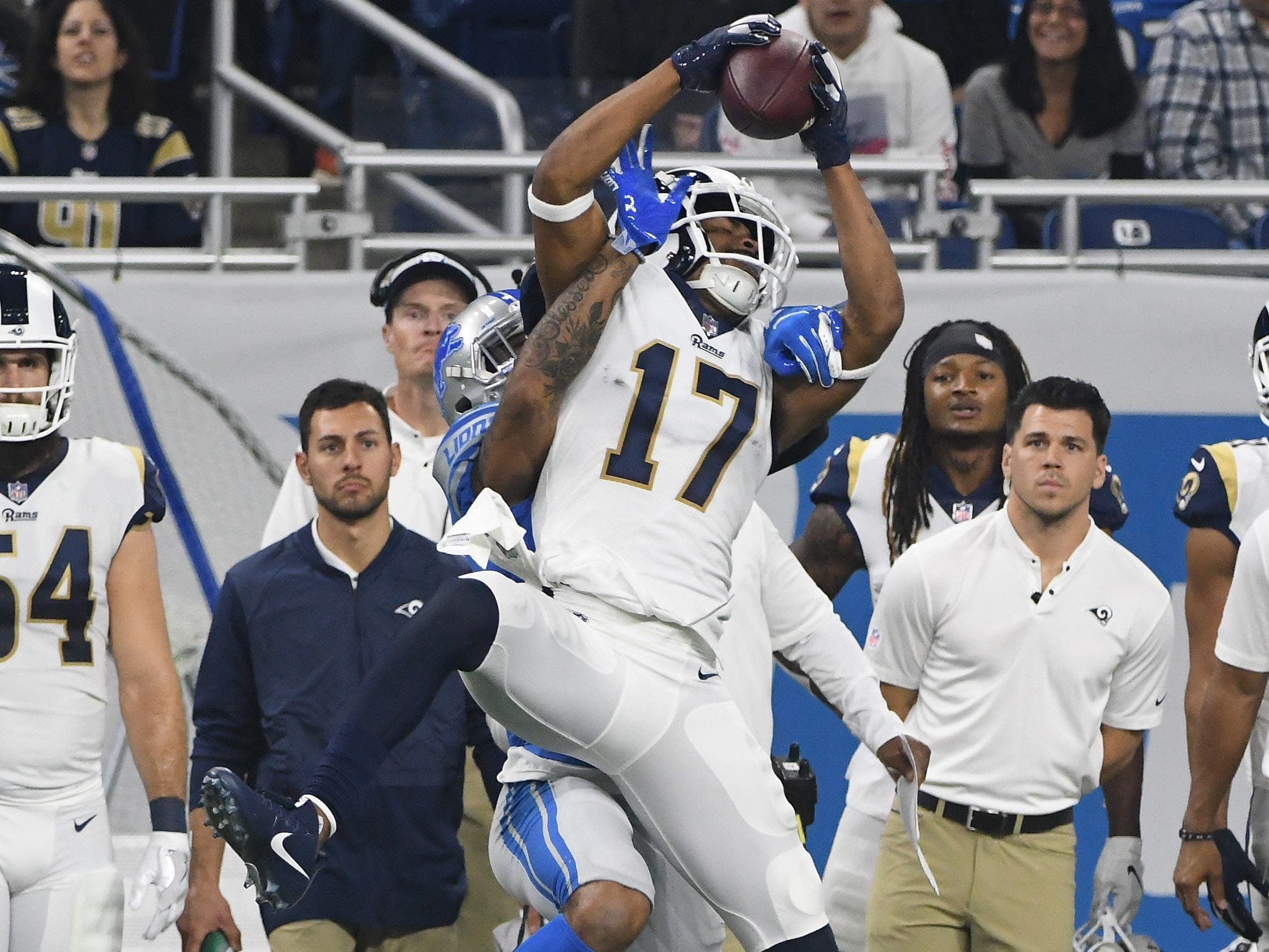 Rams' Robert Woods pulls in a reception in front of Lions' Darius Slay down the sidelines in the first quarter.