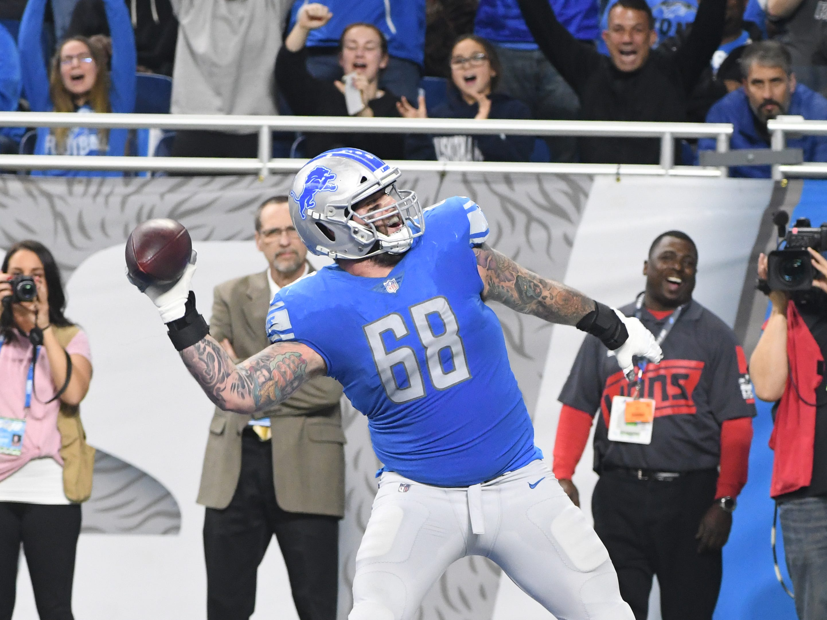 Lions' Taylor Decker throws his touchdown ball into the crowd after scoring in the third quarter.