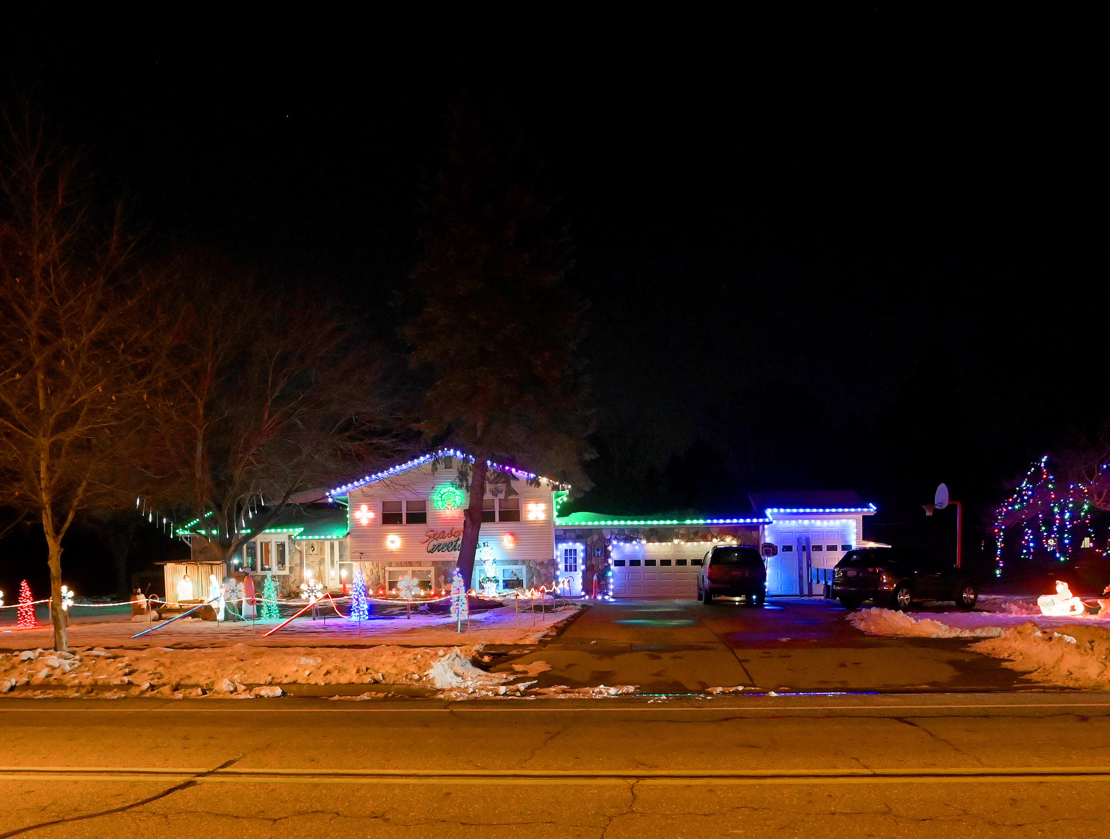 This extensive lighted display on a triple lot on Creyts Road, south of Lansing, includes a creche, Santa, snowmen and a host of Christmas trees.