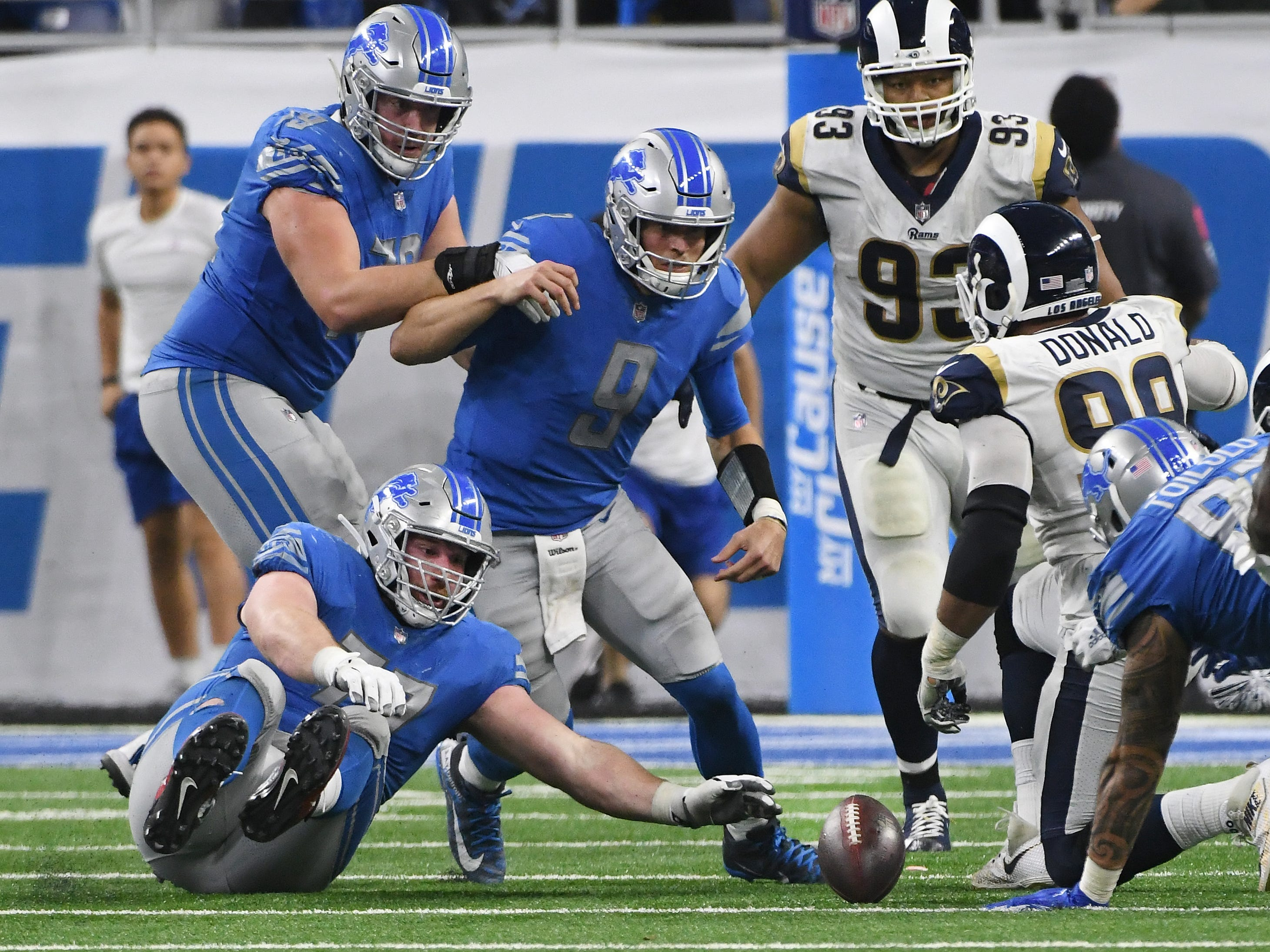 The Lions' Frank Ragnow and Matthew Stafford see Staffords fumbled football but can't get to it with the Rams recovering in the fourth quarter.
