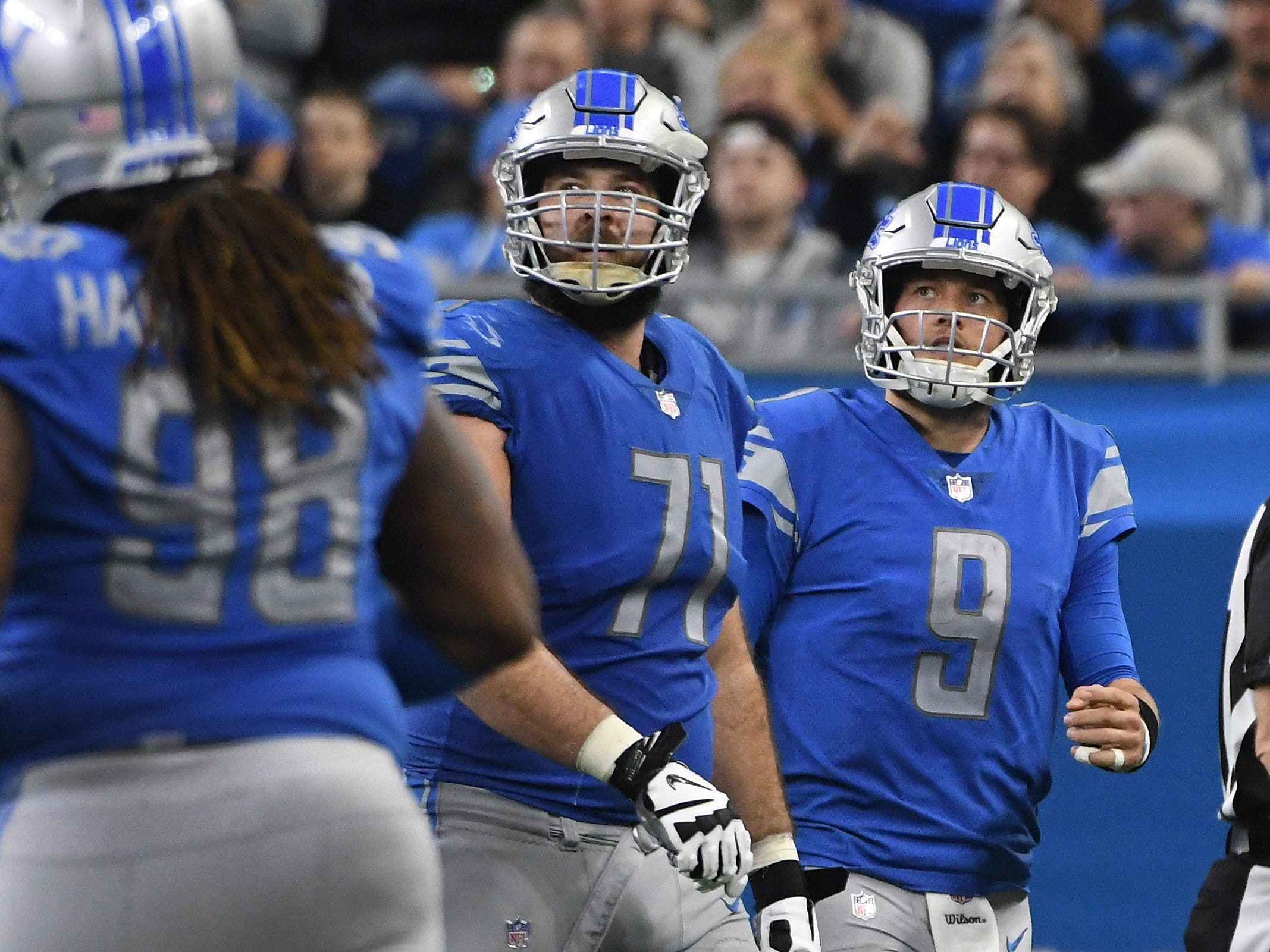 Lions' Rick Wagner and Matthew Stafford watch the replay of Stafford's fumble, with Los Angeles recovering in the fourth quarter.