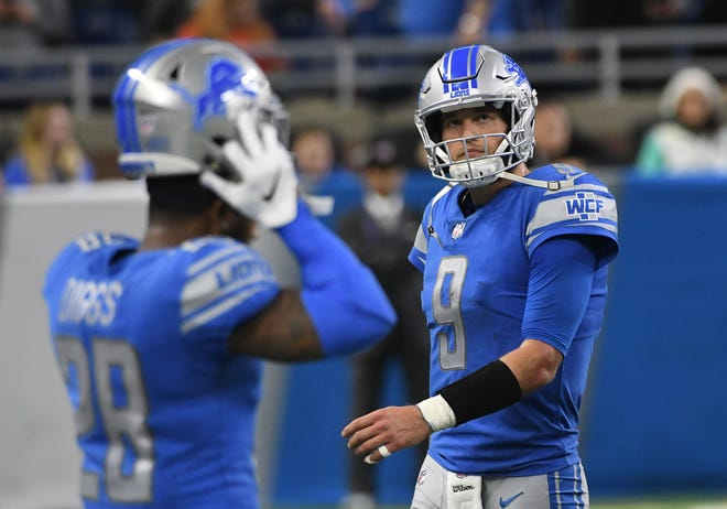 Lions quarterback Matthew Stafford walks off the field after throwing an interception that sealed Sunday's loss.