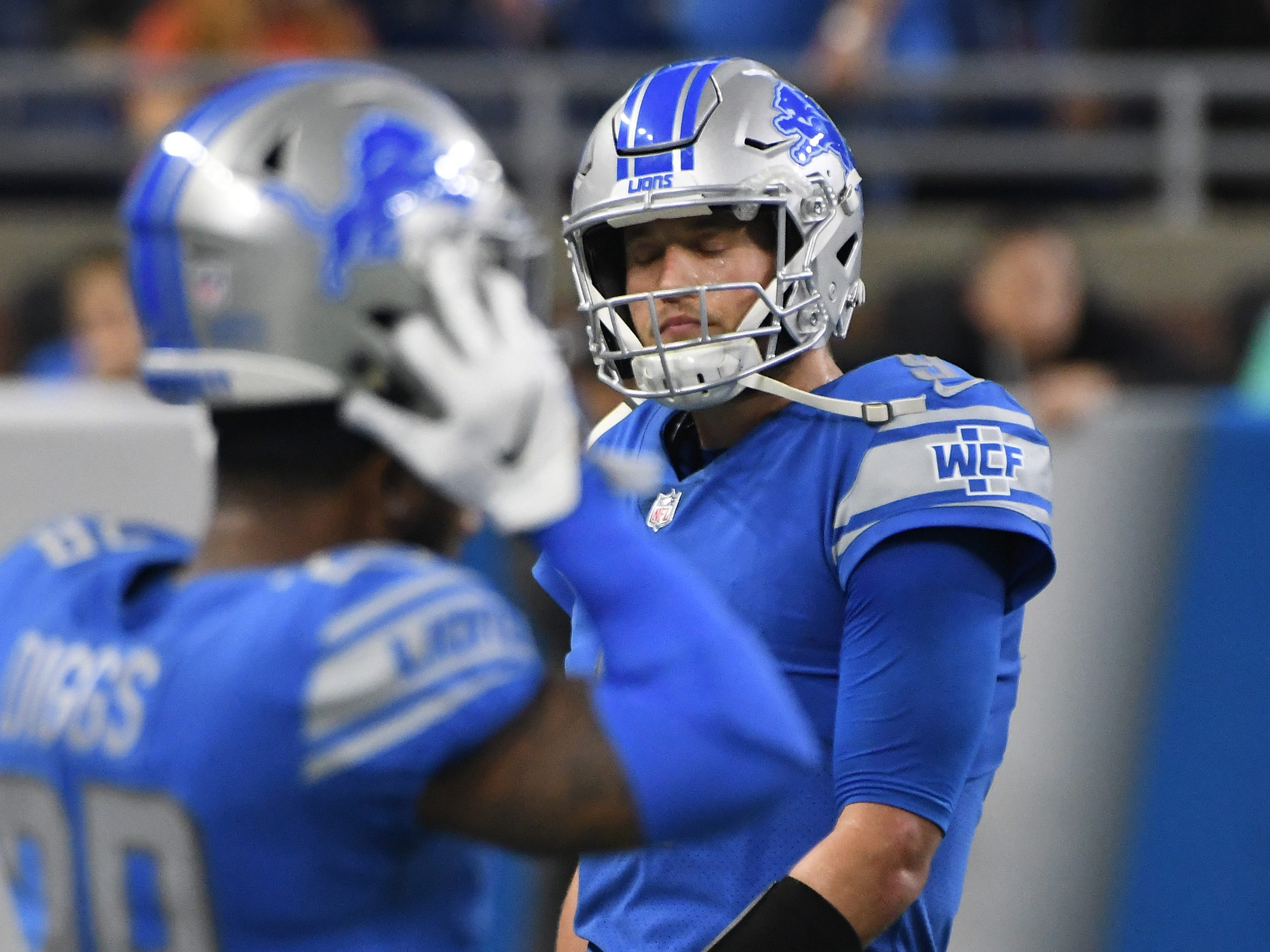 Lions quarterback Matthew Stafford walks off the field after throwing an interception, turning the ball over to the Rams who ran out the clock late in the fourth quarter.
