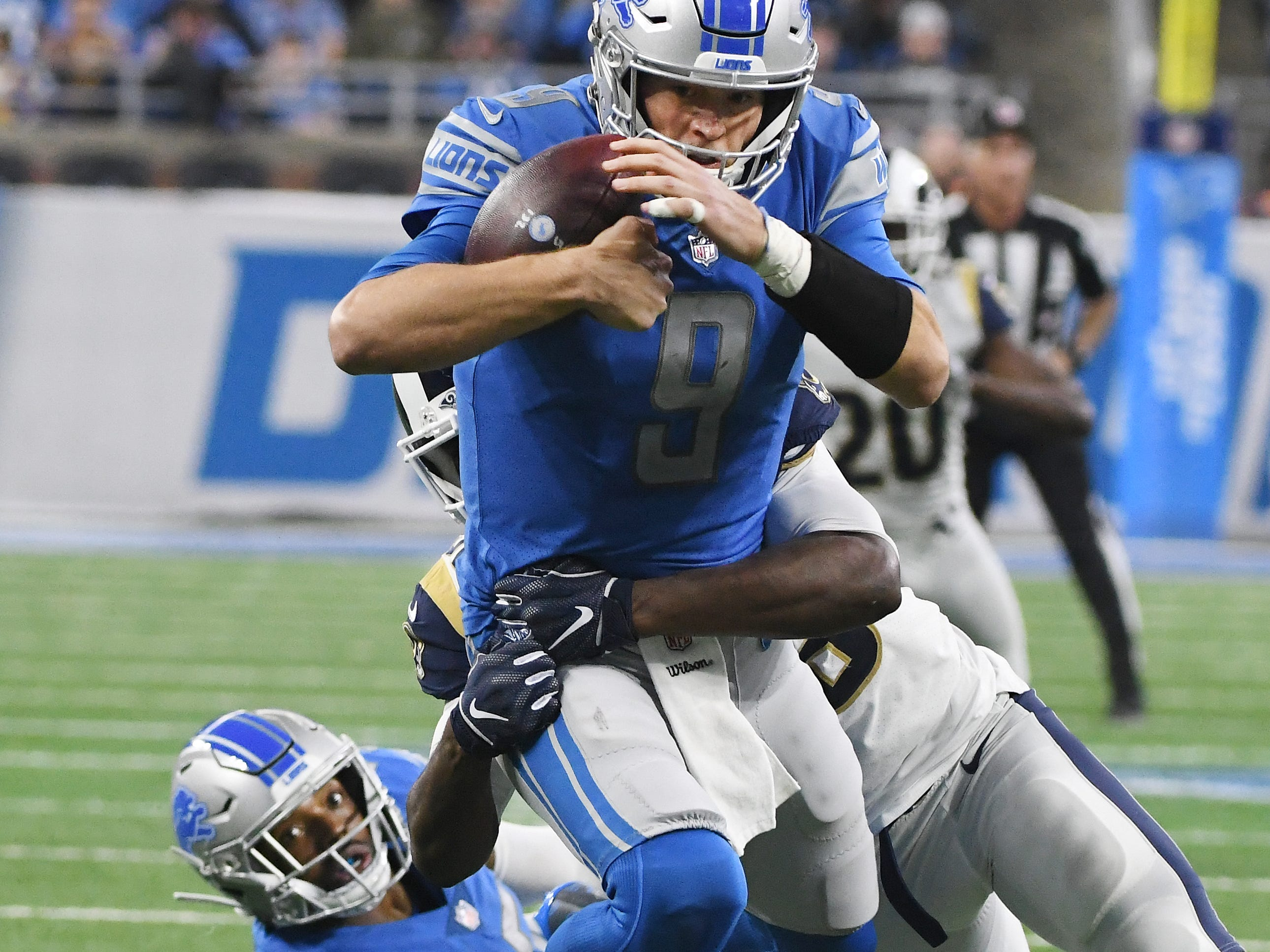 Rams' Cory Littleton gets by Lions' Theo Riddick and sacks Lions quarterback Matthew Stafford in the second quarter.