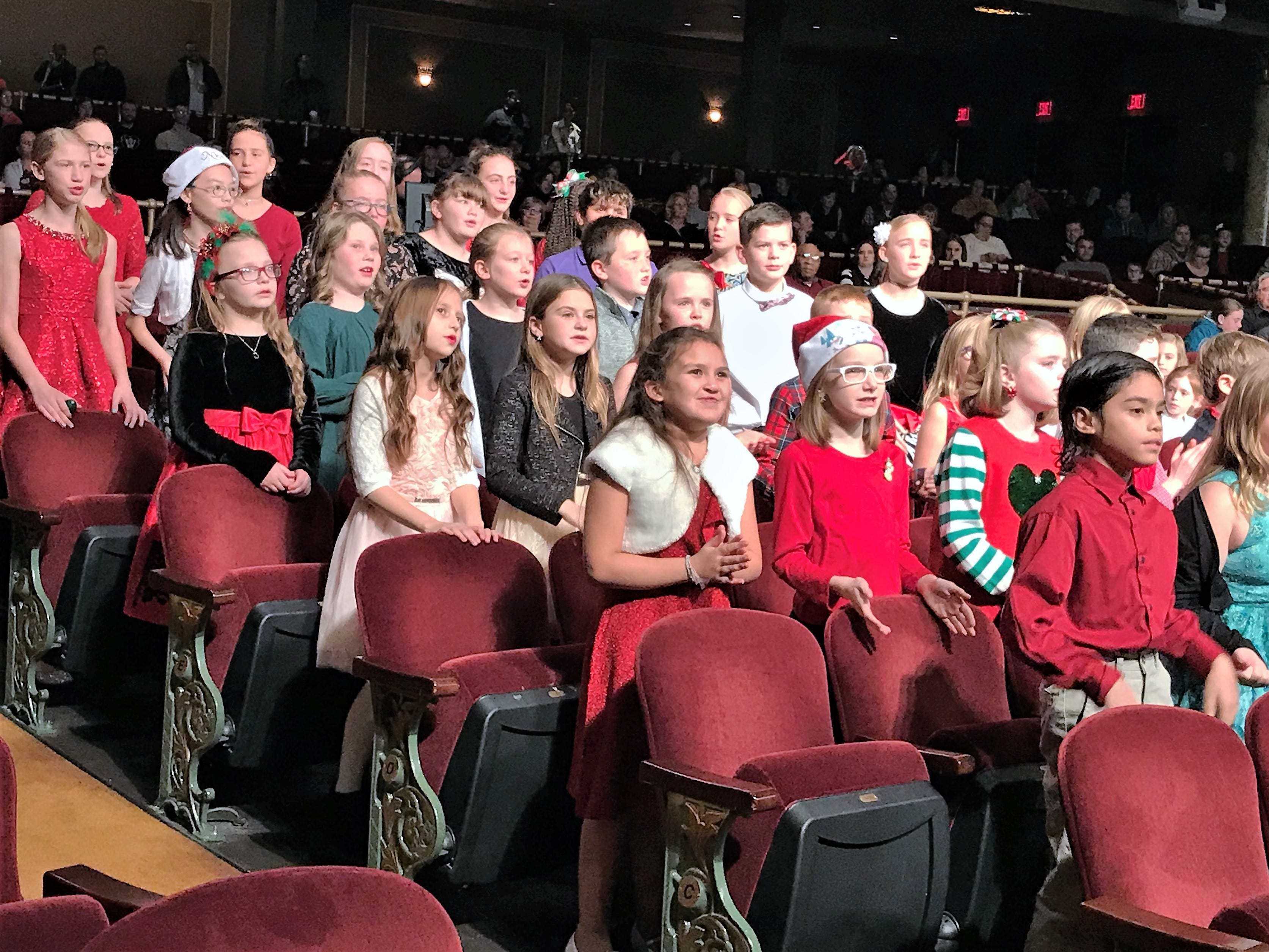 Students from Holy Family and St. Mary Our Mother choral group sing a number during Sunday's Arctic League broadcast.