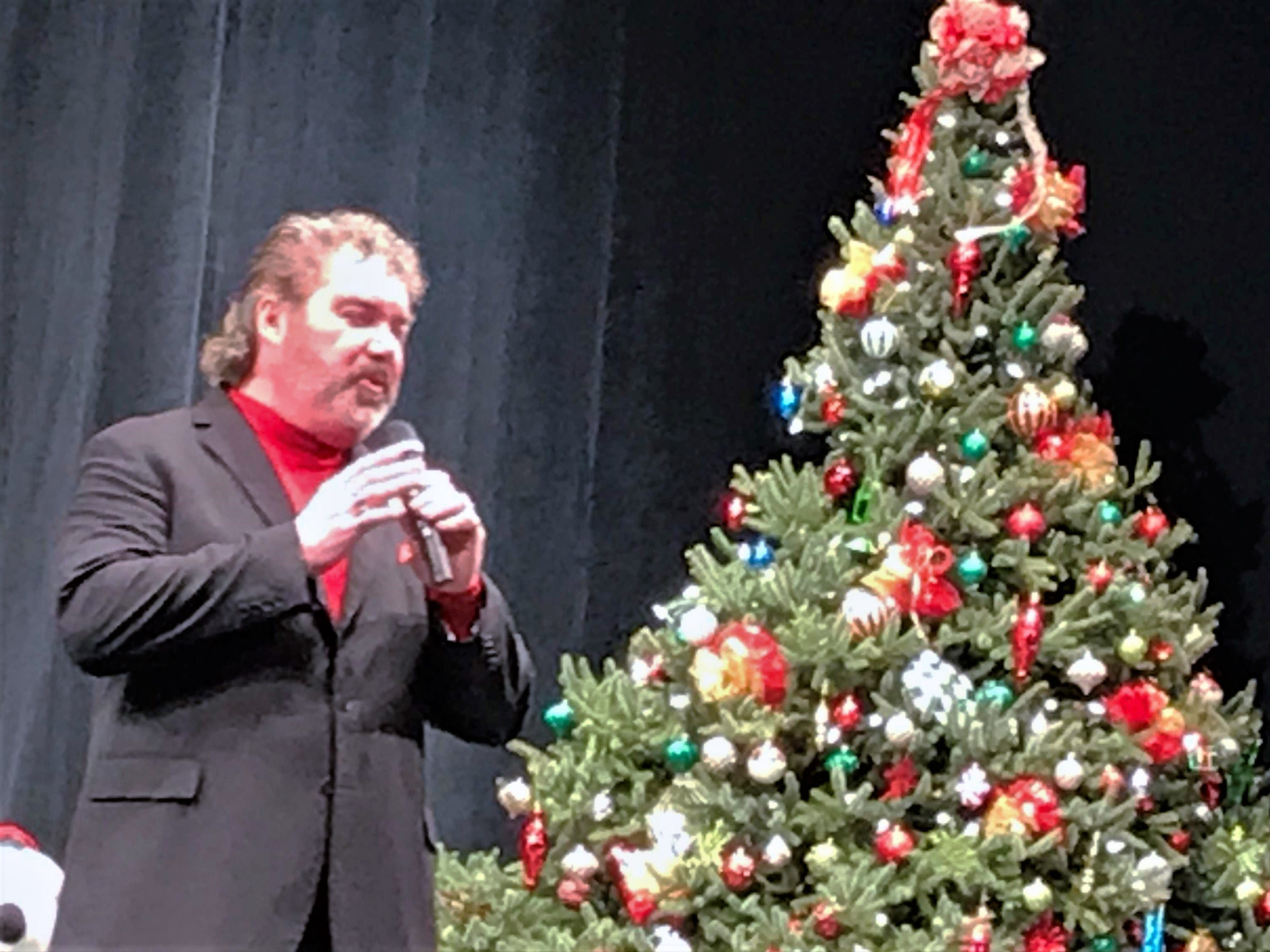 Tenor Mike Burrell sings a Christmas song during Sunday's annual Arctic League broadcast.