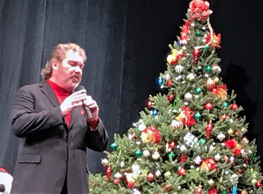 Tenor Mike Burrell performs in front of the Christmas tree during the 2018 Arctic League broadcast. The league is looking for a new tree for this year's show.